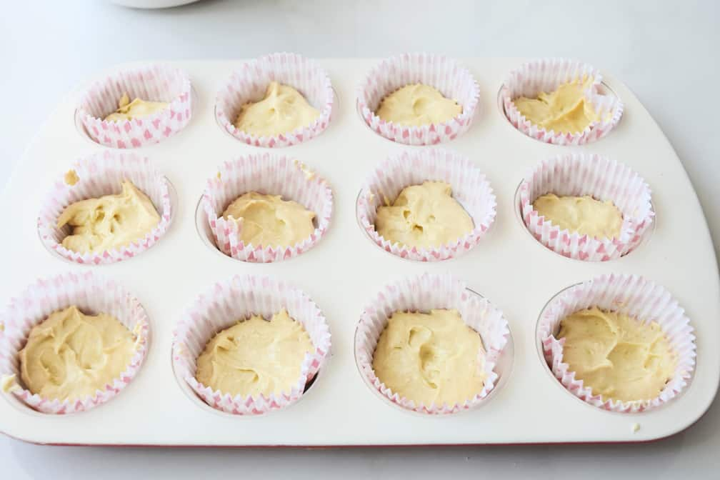 cupcake batter placed in 12 cupcake cases