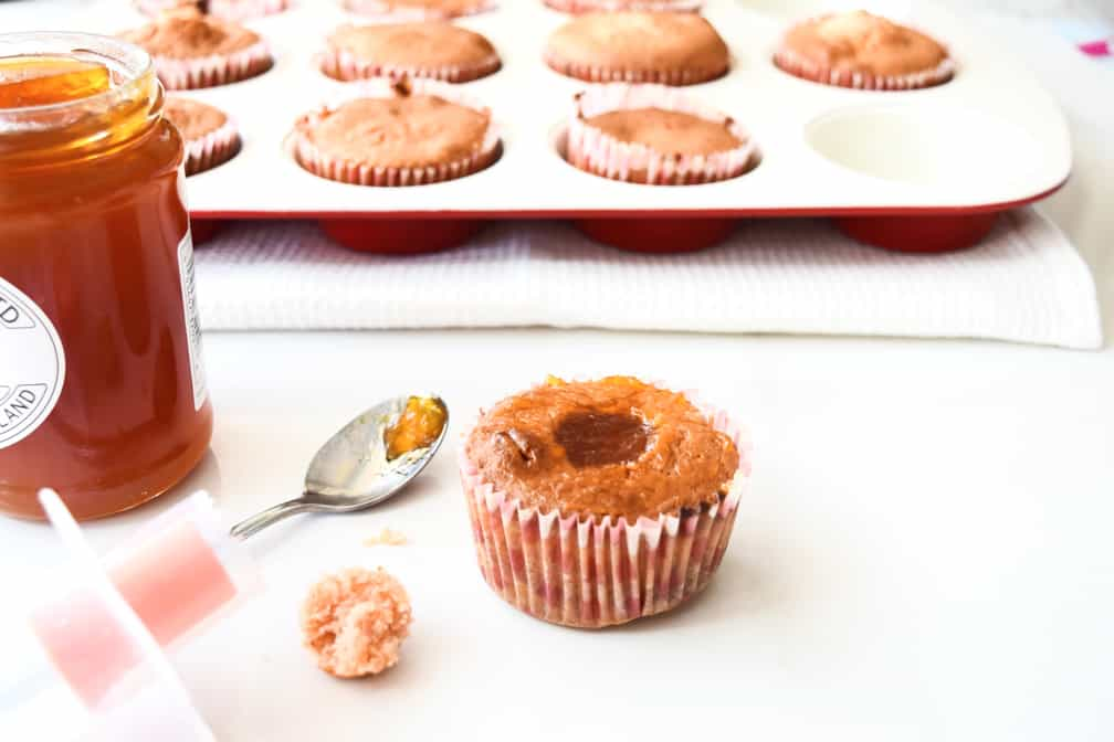 example of filling the cupcakes with jam