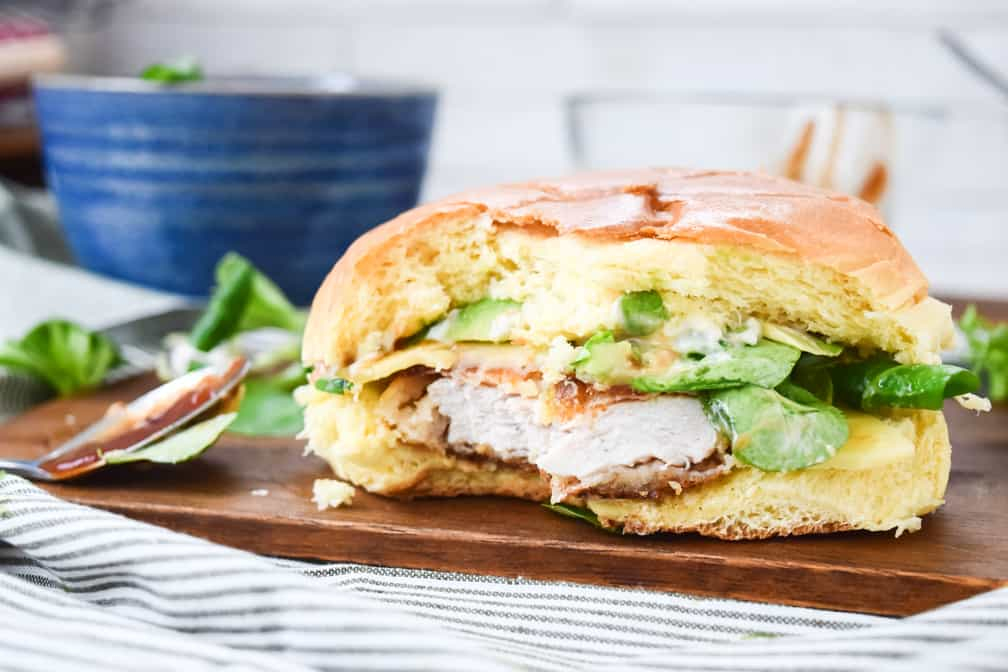 chicken burger with a bite missing