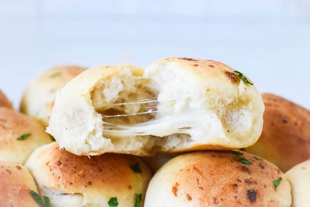 mozzarella stuffed garlic doughballs broken open