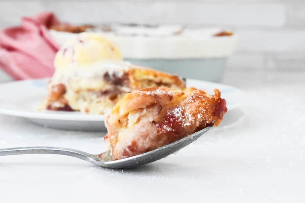 doughnut pudding on a spoon