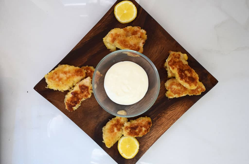 Overhead view of chicken bites with dip and lemon mayo