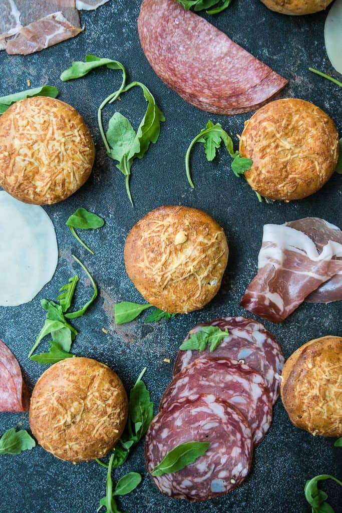 overhead display of scones surrounded by deli meat and rocket salad