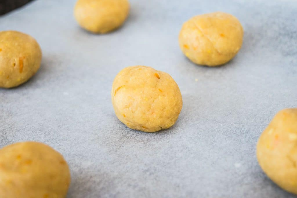 uncooked dough for the ginger nuts recipe rolled into balls.