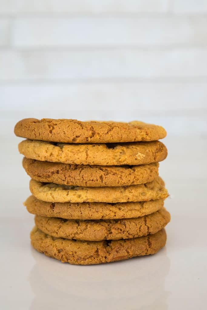 gingernut biscuits stacked in a pile
